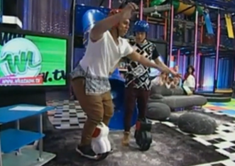 On 5 April, Airwheel two-wheeled scooter showed on New Zealand entertainment programme called WhatNow. Two young hosts were given the challenge and, in the end, successfully learnt to steer two-wheeled scooters.